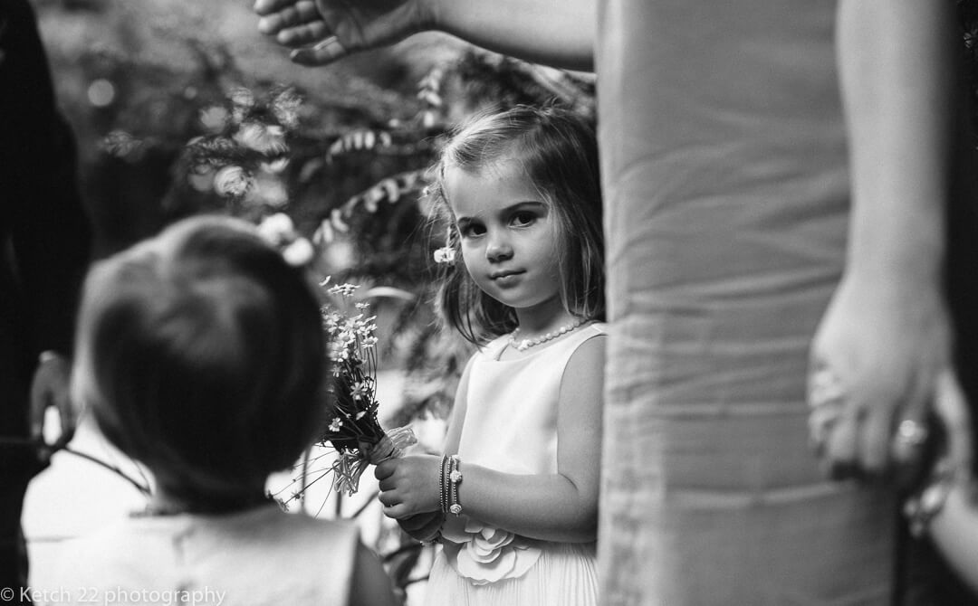 Flower girl looking into the camera before wedding ceremony