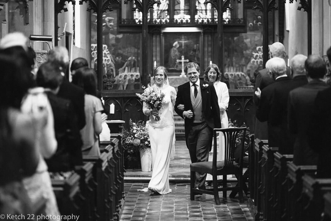 Bride and groom leaving church after wedding ceremony
