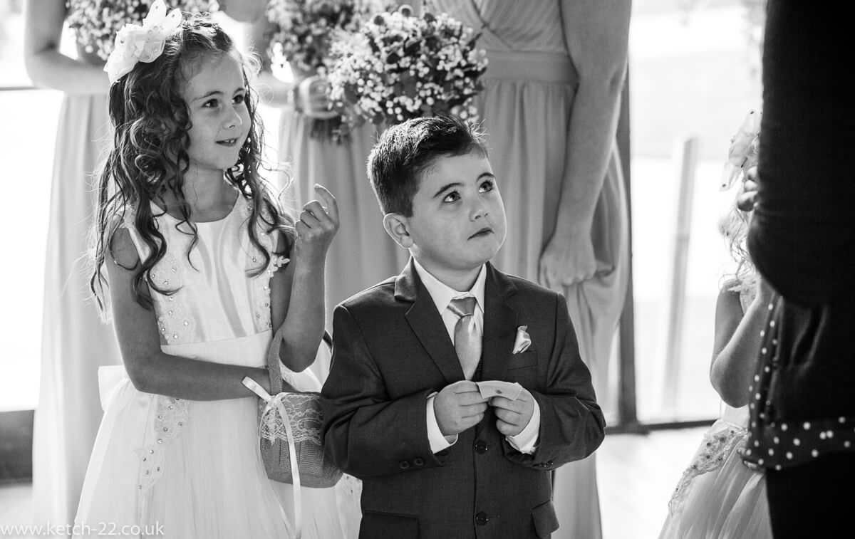 Page boy and flower girl prepare to enter wedding ceremony