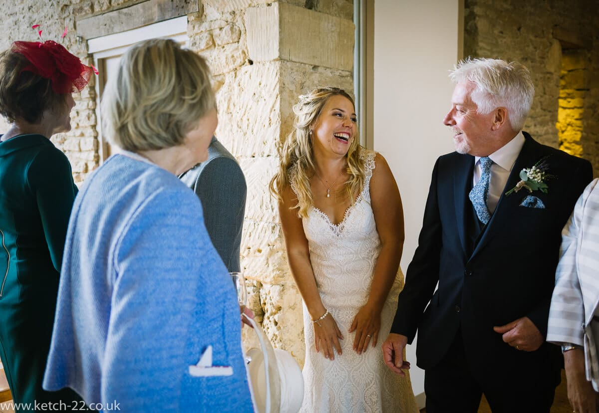 Bride laughing with her father