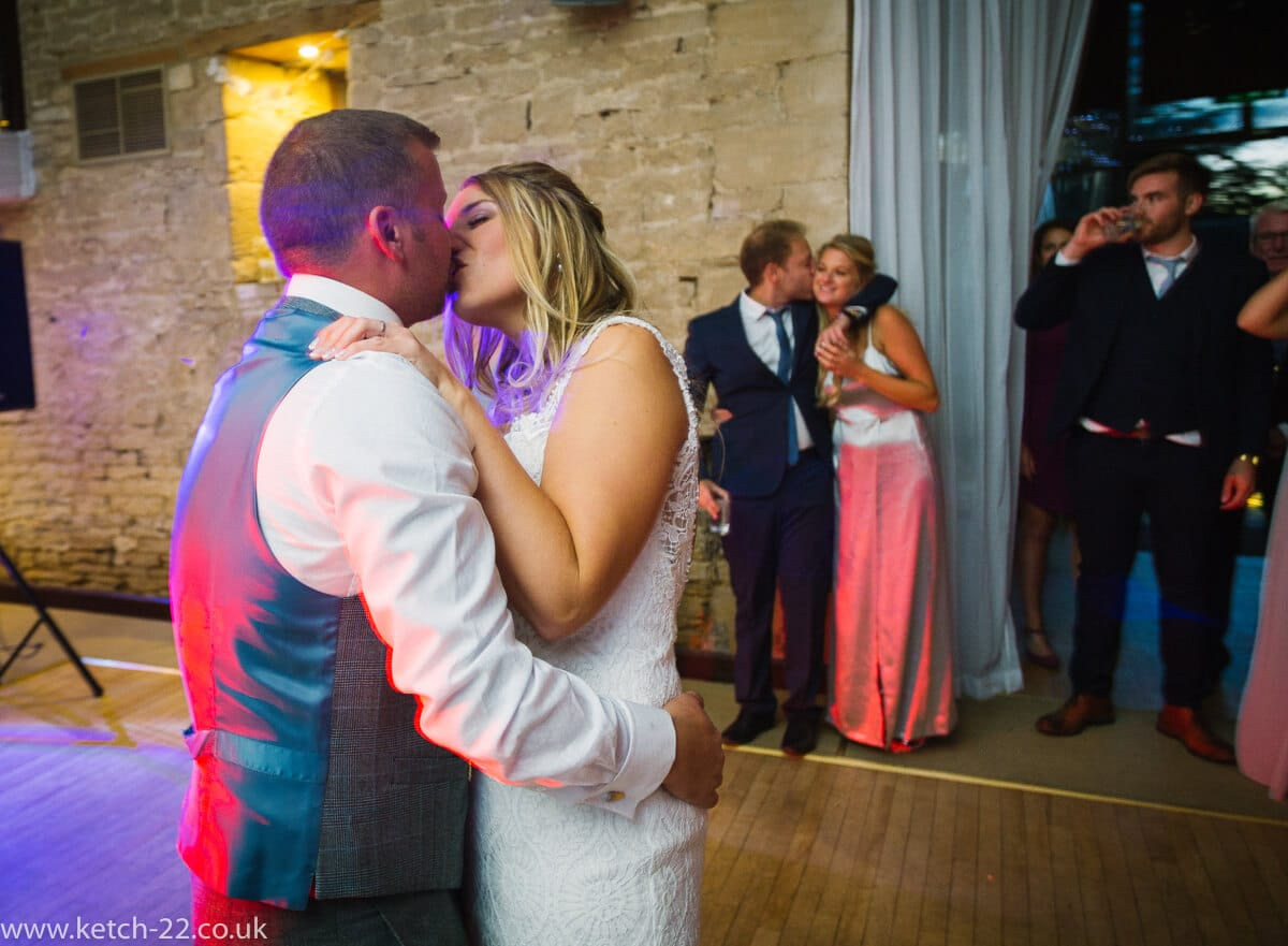 Bride and groom kissing at first dance