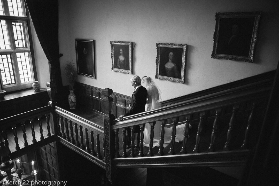 Father and bride descending stair case at Country House wedding