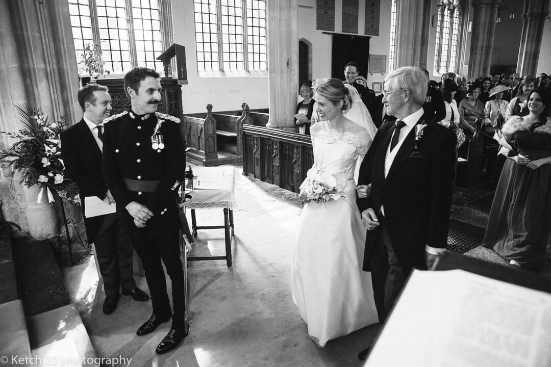Bride and groom look at eachother for first time at wedding ceremomy