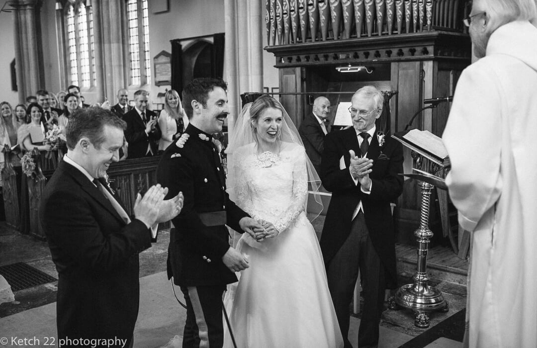Bride and groom laughing at wedding cremony
