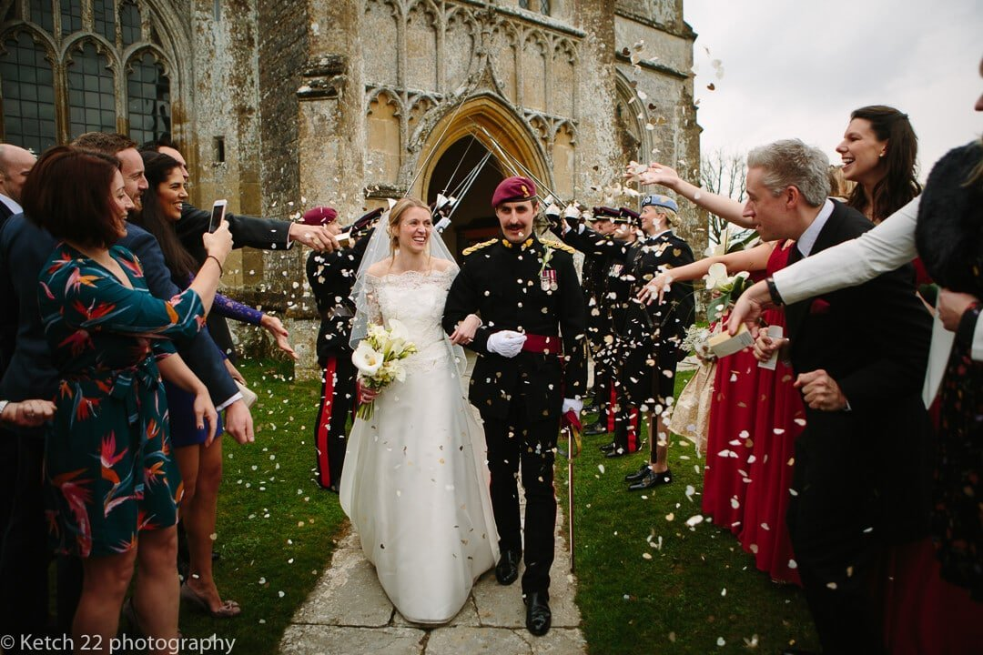 documentary wedding photo of bride and groom getting showered with confetti at Somerset wedding