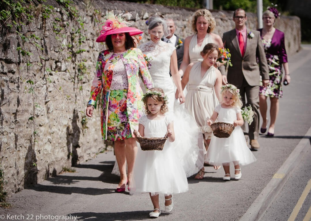 Bridal party walking down road at Hay on Wye wedding