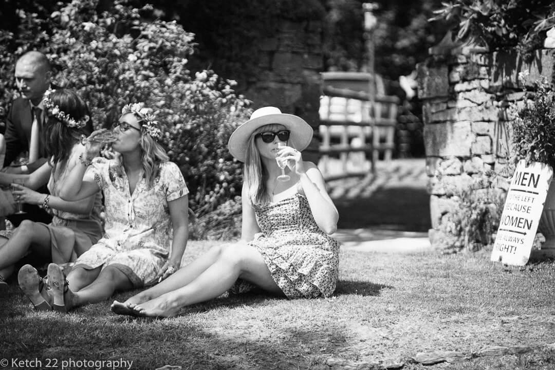 Wedding guests relaxing in garden