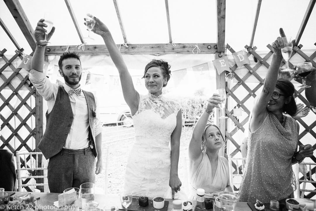 Bride and groom toasting at wedding speeches
