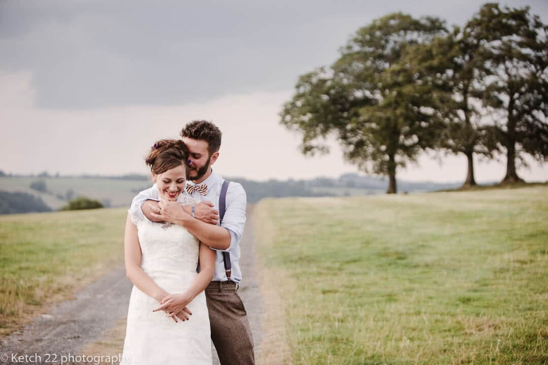 Romantic portrait of bride and groom in rural setting