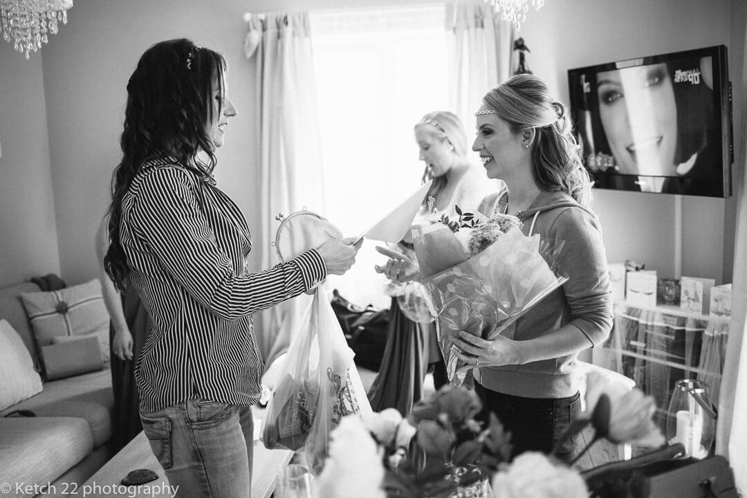 Bride giving out gifts to bridesmaids at wedding preparations