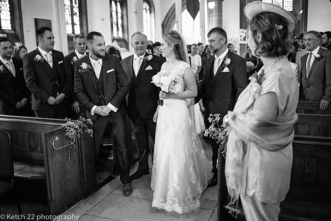 Bride and groom look at eachother just prior to wedding ceremony