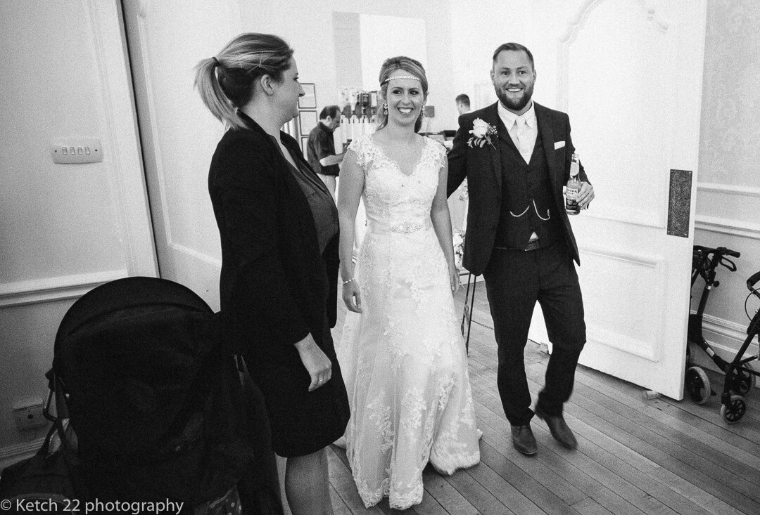 Bride and groom enter dining room at wedding