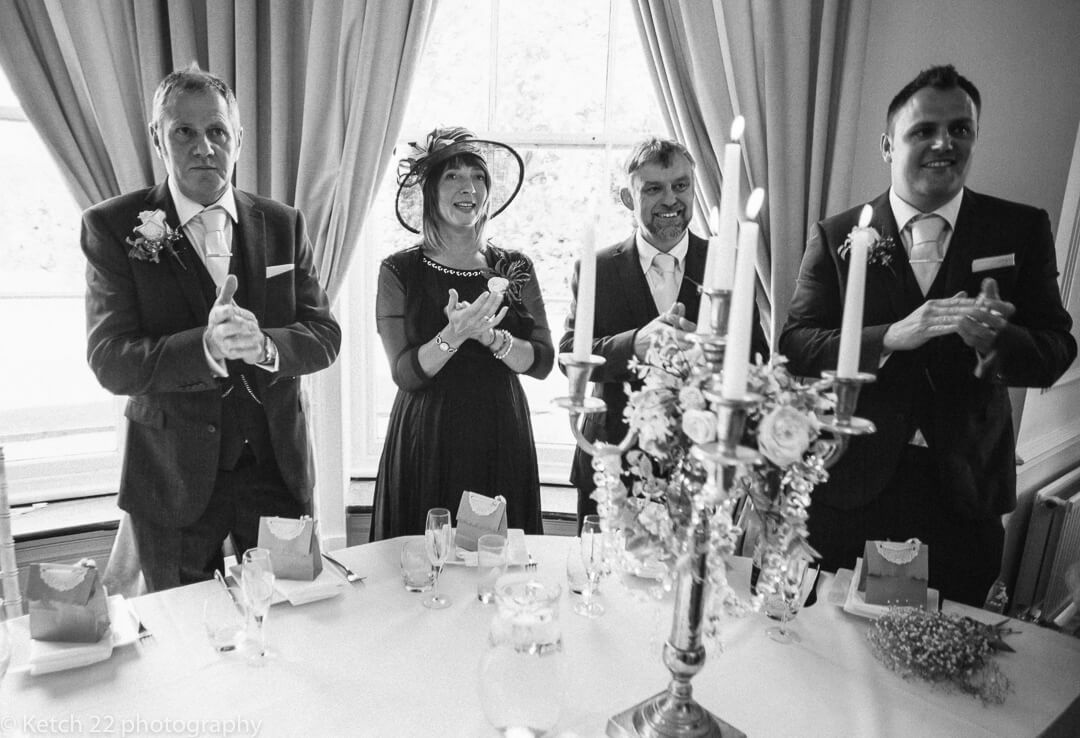 Wedding guests cheering bride and groom