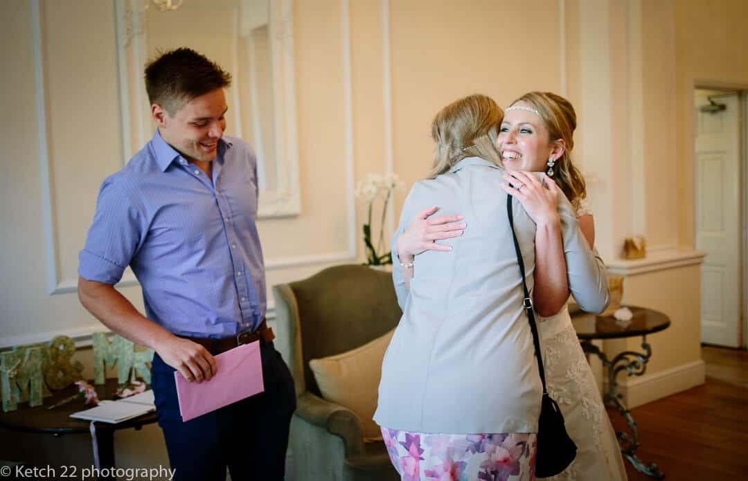 Bride hugging wedding guest in Gloucestershire