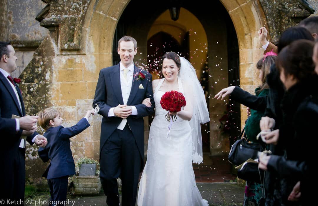 Bride and groom get showered with confetti