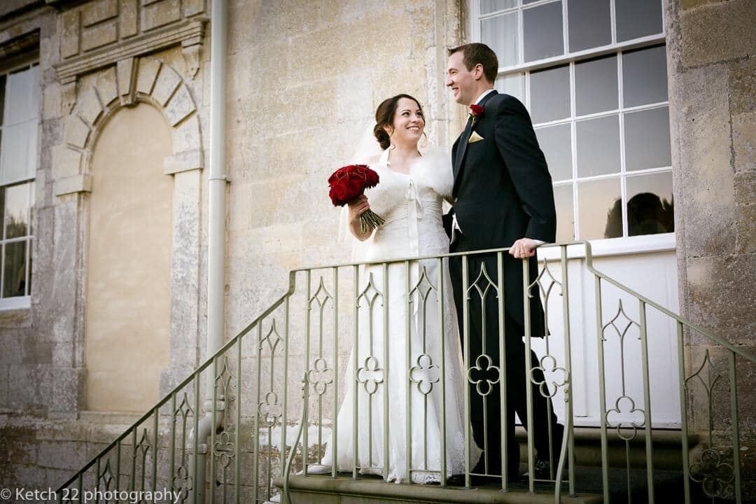 Bride and groom standing at top of steps at Elmore Court wedding