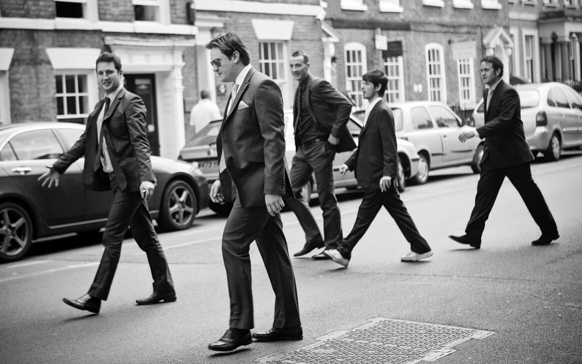 Groom and ushers crossing road at Cheltenham wedding