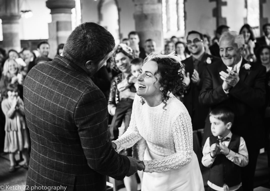 Bride and groom laughing just after exchanging vows in Gloucestershire wedding