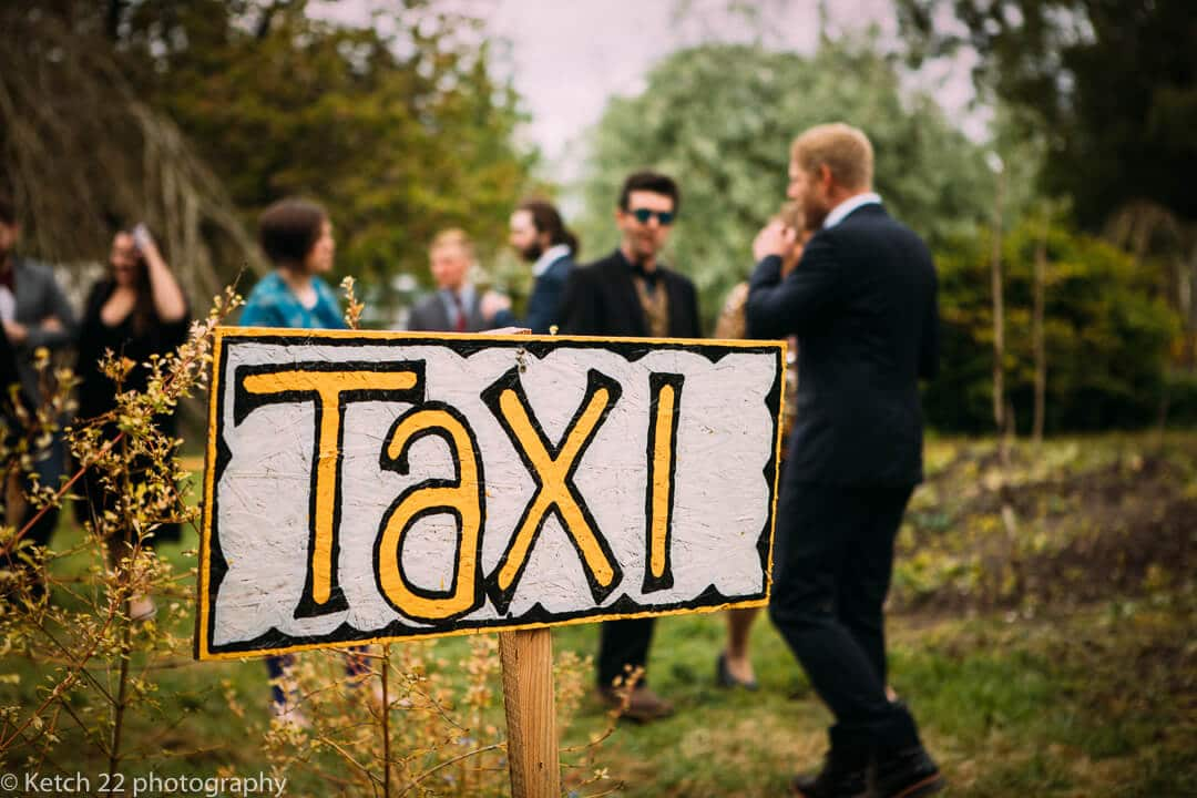 quirky taxi sign at wedding reception