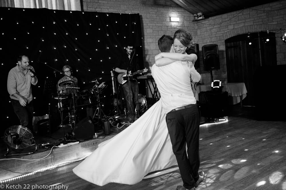 Groom swinging bride at first dance at The Barn at Berkeley wedding in Gloucestershire