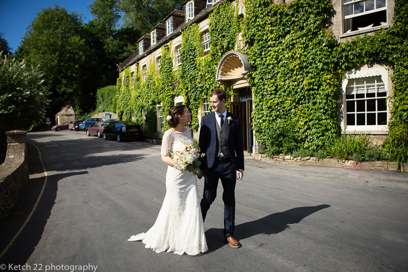 Bride and groom outside The Swan at Bibury wedding Gloucestershire