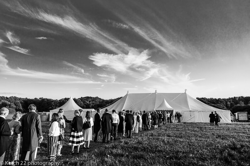 Wedding guests outside marquee at Dorset summer wedding