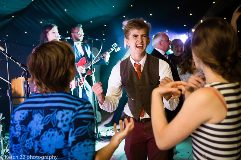 Wedding guest dancing to rock and roll in Dorset