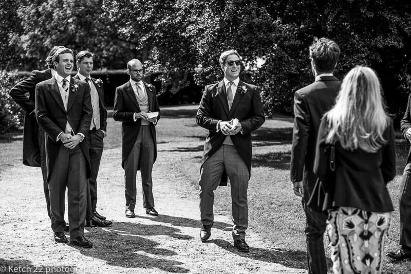 Ushers greeting guests at Dorset Summer wedding
