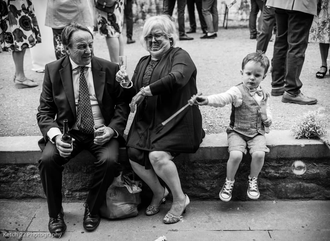 Kid Playing With Bubbles And Upsetting Grandma At Gloucestershire Wedding