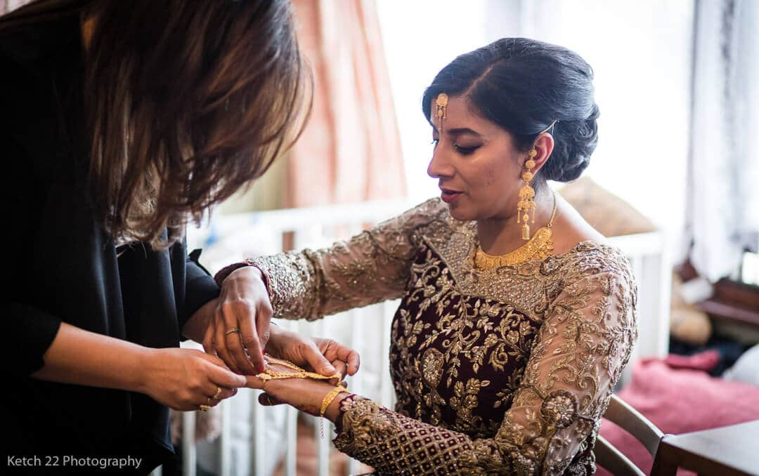 Bride getting ready for Muslim wedding in Southall