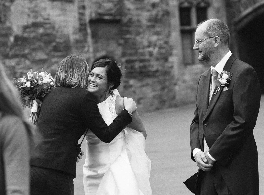 Bride hugging weding guest at Berkeley castle