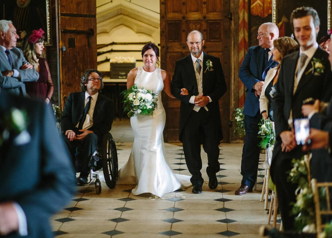 Bride and father walking down aisle at Gloucestershire wedding