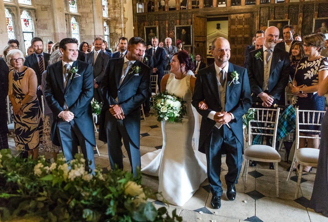 Groom looking at bride just prior to wedding ceremony