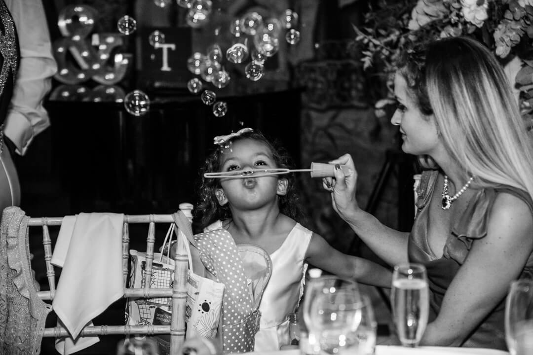 Flower girl blowing bubbles
