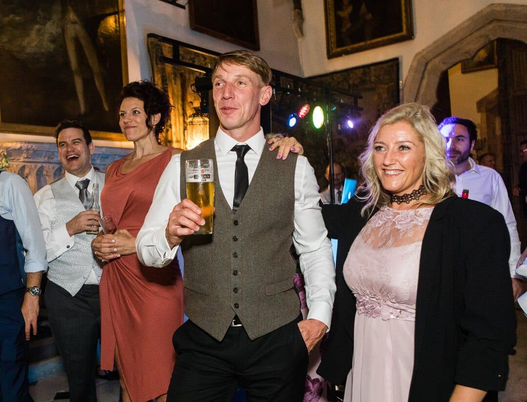 Wedding guests watching bride and groom
