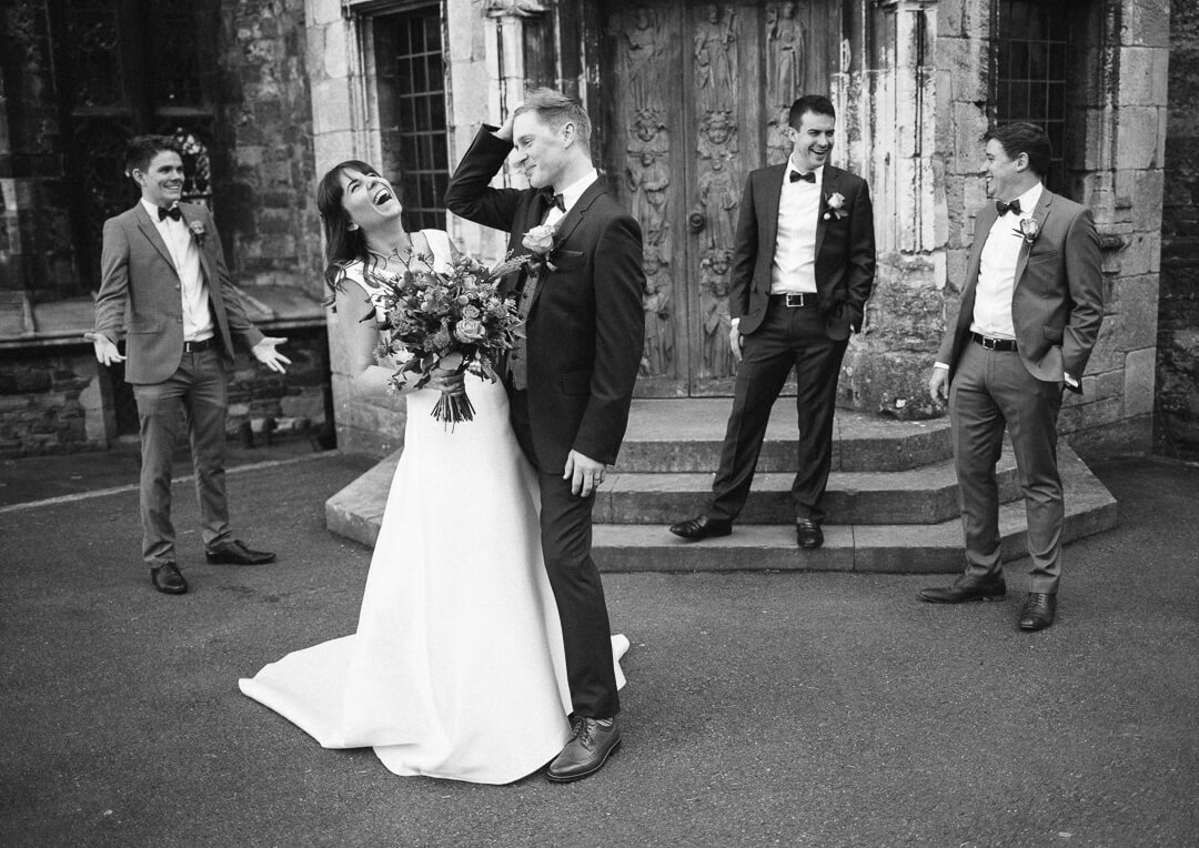 Quirky portrait of bride and groom at Berkeley castle wedding Gloucestershire