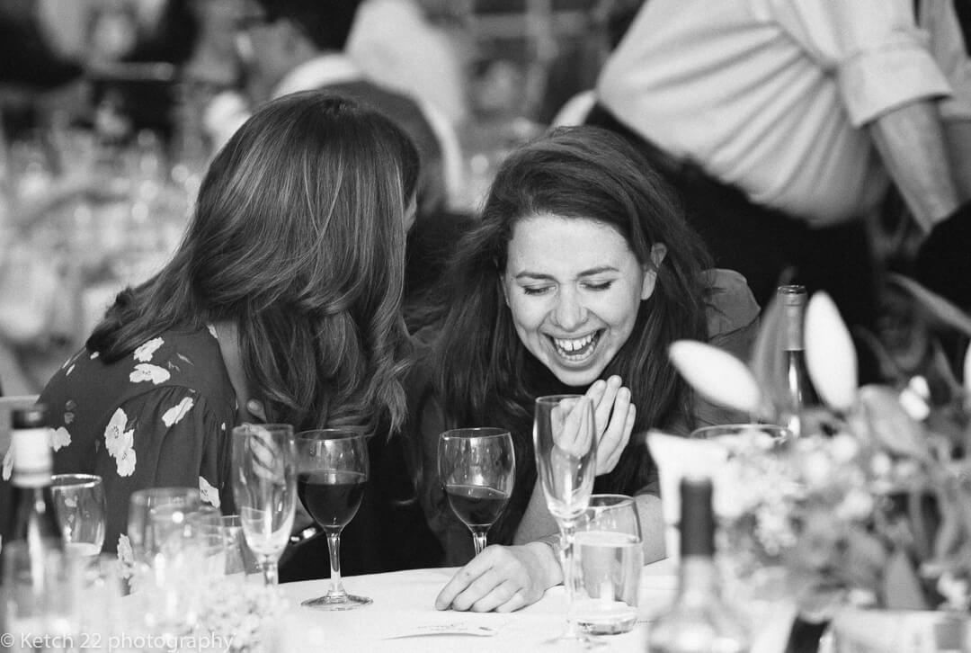Wedding guests laughing during the speeches