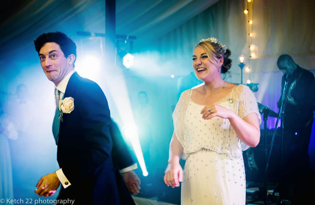 Groom fooling around during first dance at Oxfordshire wedding