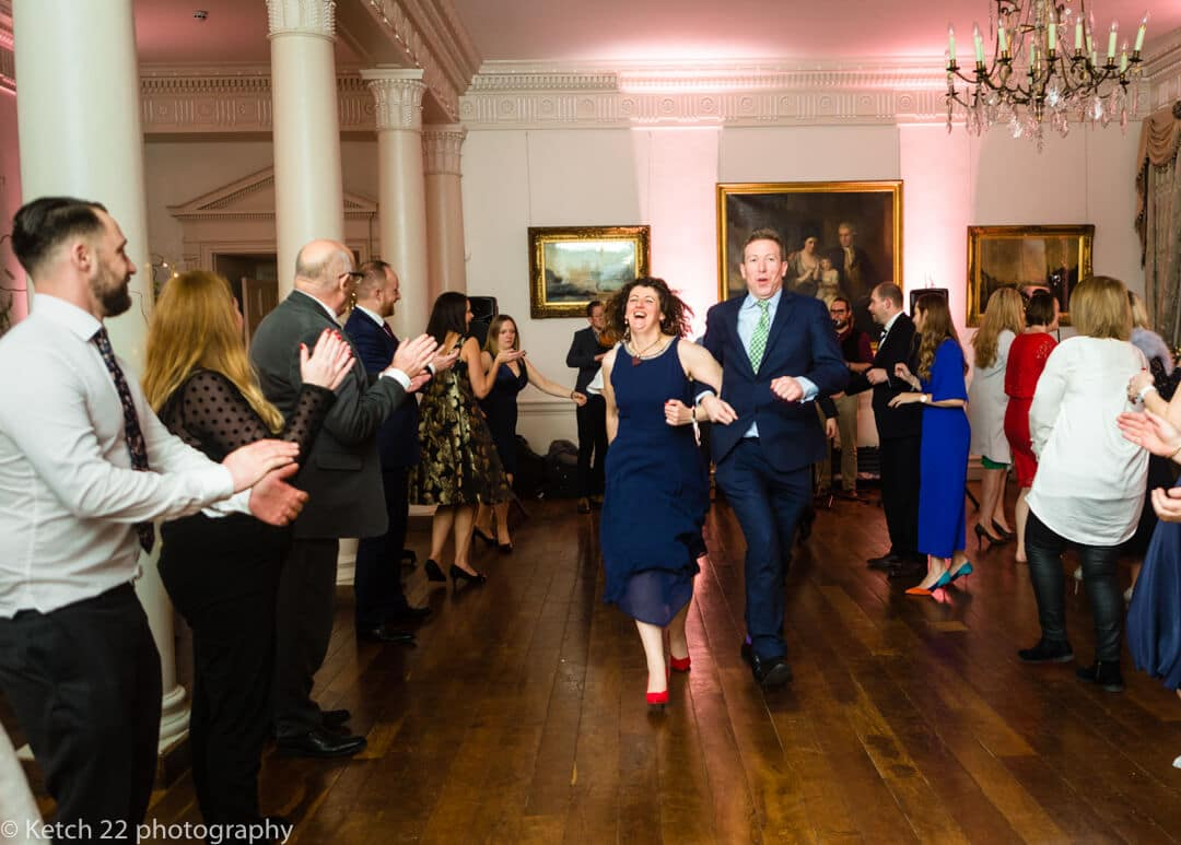 Wedding guests dancing at country house in Somerset