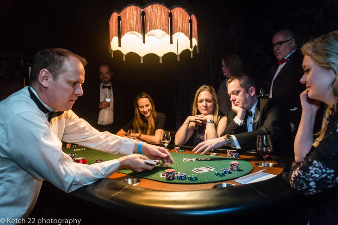 Reportage wedding photography at North Cadbury Court with guests gambling at the casino