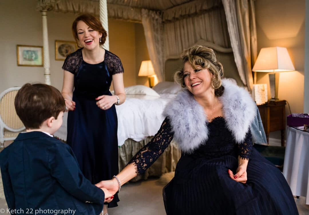 Bridesmaids playing with page boy at Winter wedding