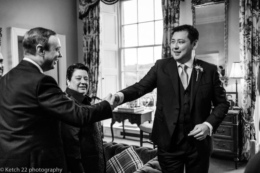 Groom greeting guests at North Cadbury Court wedding