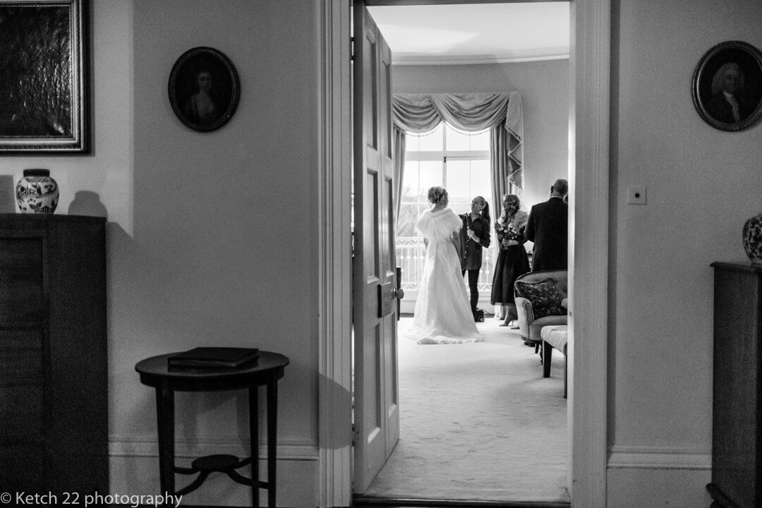 Bride making her final preparations just before the wedding ceremony