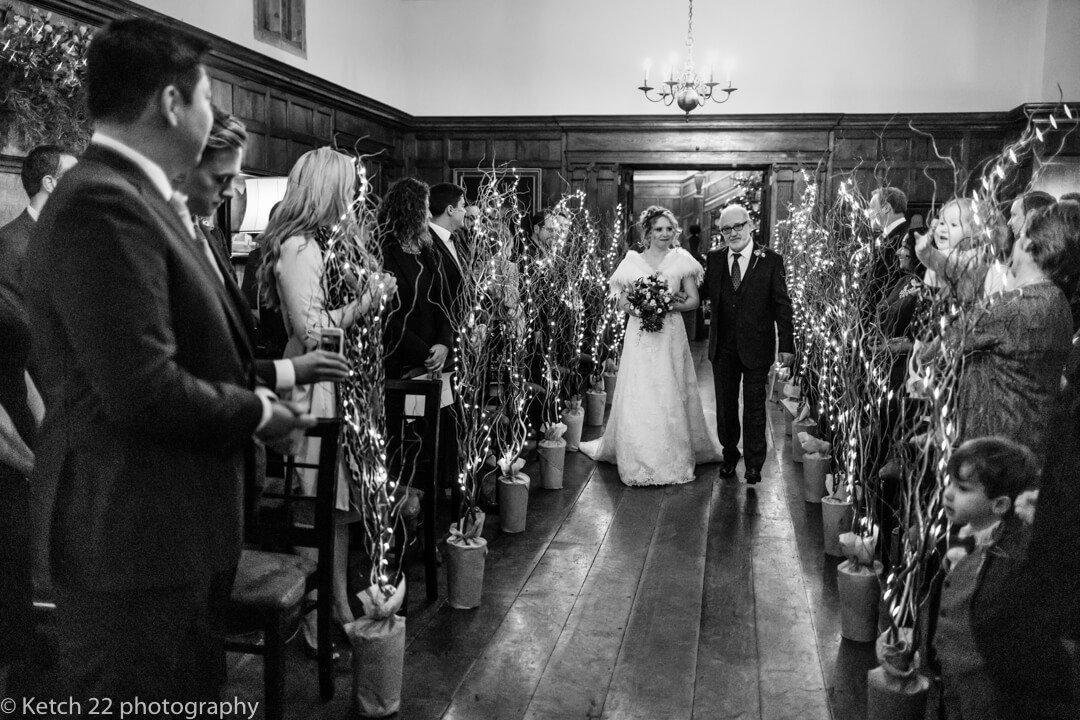 Bride walking down aisle at Christmas wedding at North Cadbury Court