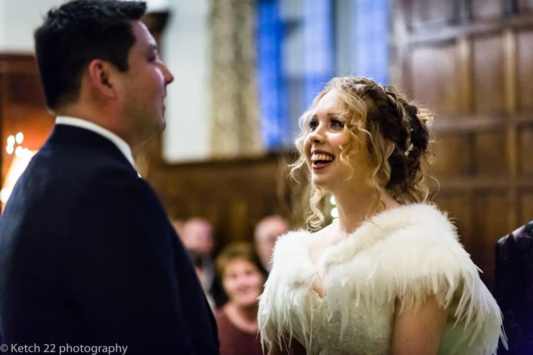 Storytelling wedding photo of bride and groom taking vows at wedding ceremony