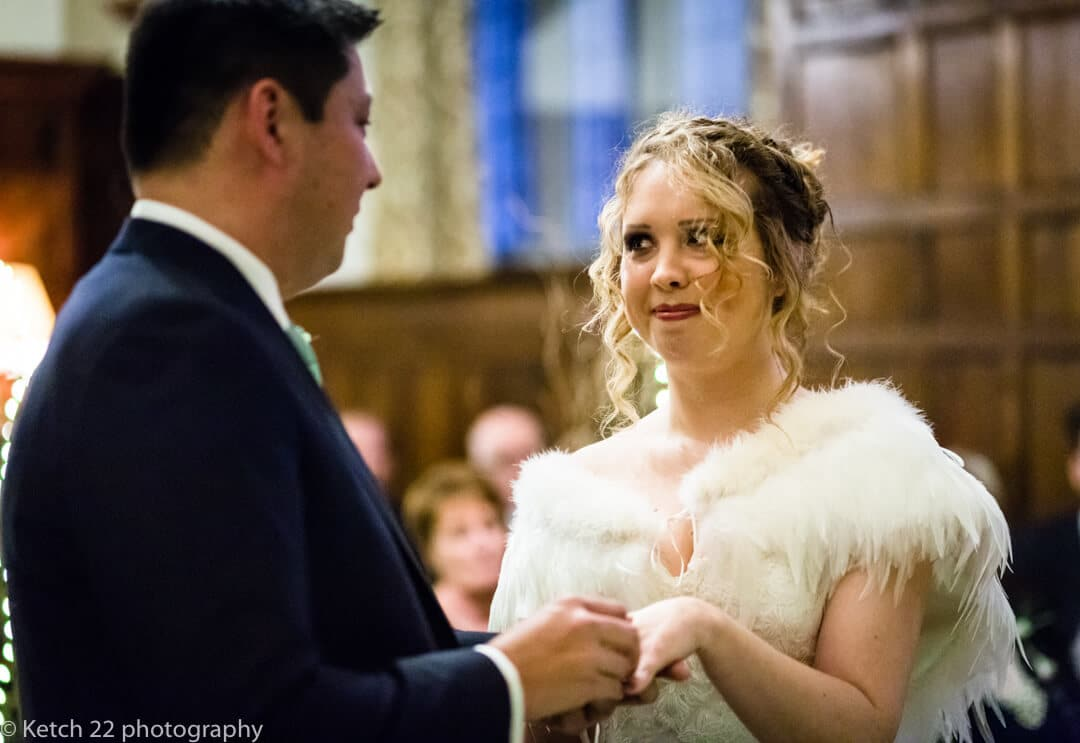 Reportage wedding photography of bride looking at groom during wedding ceremony