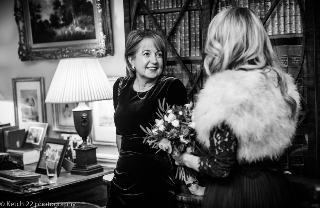 Wedding guest chatting at reception