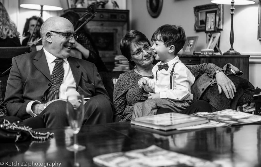 Documentary wedding photo of little boy with family