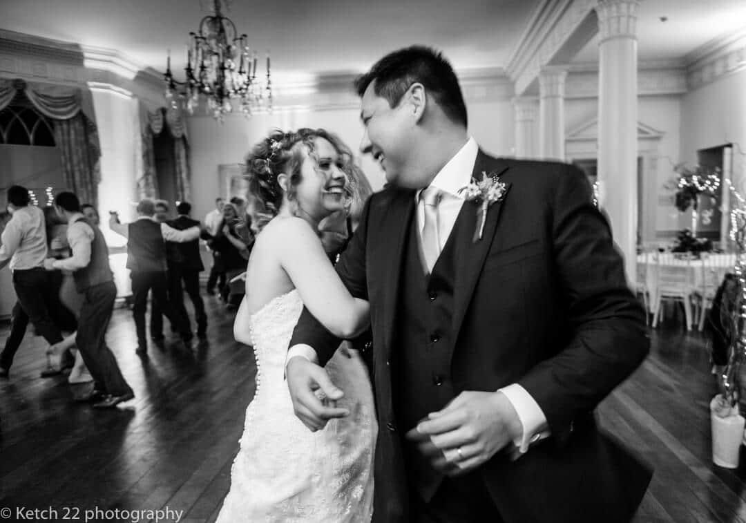 Reportage wedding photography of bride and groom dancing