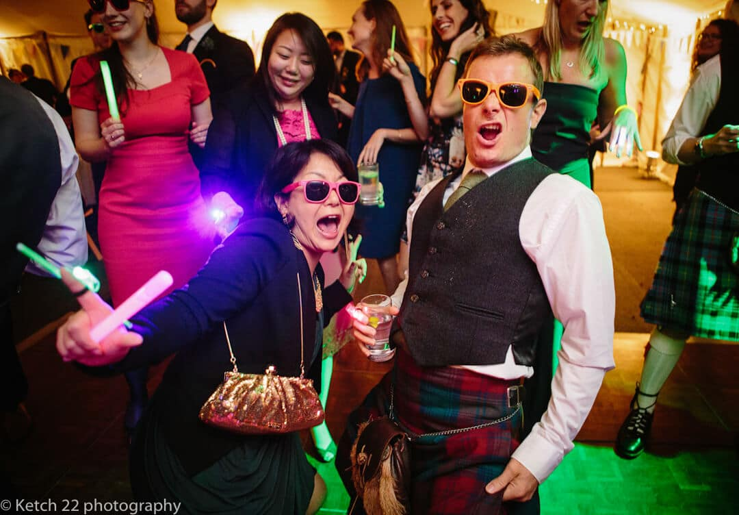 Wedding guests with sunglasses dancing